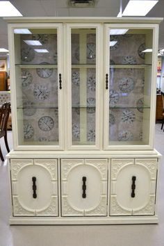 """Antique White Shabby Chic """"Sklar Peppler""""China Cabinet with Clock Theme Backing and Lights - 2 Glass Shelves, Flatware Drawer and 3 Lower Cupboards - Beautifully Refreshed! 54.5"""" W x 72.25"""" H x 17"""" D"""