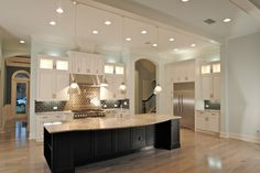 Jeff Reed, Cabinetry Designer for Fox Signature Homes. Kitchencraft Integra Lexington Alabaster with Pewter Glaze.  Typhoon Bordeaux Granite tops. Island is Espresso on Maple. Pin via Ricky Henderson