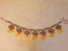 Home decor for Diwali Wooden Paisley and colorful beads make up this special Bandhanwar Add charm to your door stem and adorn it with our designed   Bandhanwars