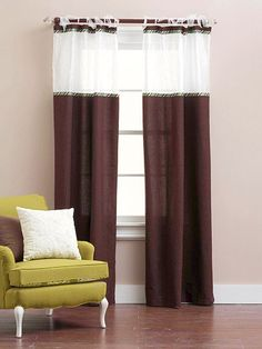 Good idea to customize inexpensive curtains or add length to a curtain.  Cut curtain about an inch from top, add fabric panel, sew the curtain back onto the bottom of added panel, cover seams with ribbon.