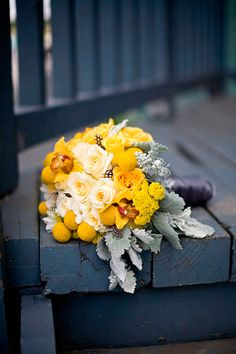 I always love the yellows and frosty greys together.  So pretty!  Does anyone know what those globe-shaped yellow flowers are called?
