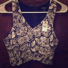 Black and white print crop top size medium Black and white printed  crop top. Zips in the back. From Express. New with tags. Express Tops Crop Tops
