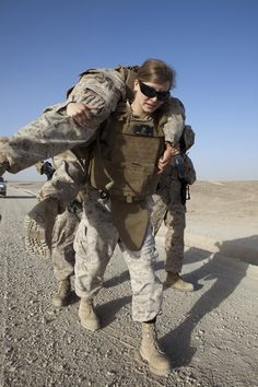 Who says women aren't strong enough? A female soldier carries a wounded buddy.