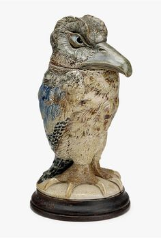 Martin Brothers bird tobacco jar, Lot #97 also did well. It sold near its high estimate of $25,000, realizing $27,500, including buyer's premium. It was slightly smaller than lot #98, but also had plenty of personality.