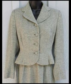 Classic 1940s women's suit with a wonderful wasp waist jacket in size medium M.  Measurements: in inches for size medium: Jacket: Bust 34, waist 28,