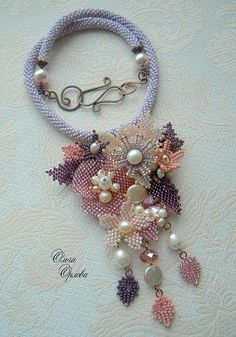 Olga Orlova is one more talanted beadwork author. She works mostly with bead embroidery and makes really delicate amazing jewelry. Her necklaces, brooches and handbags remind beautiful old-fashioned and vintage things because she uses old golden-embroidered techniques.