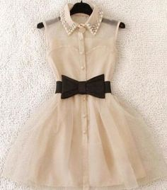 Cute dress! @Cindy Carney you should find this dress and get it for T for her first day of school =)
