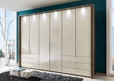 Kleiderschrank Loft Eiche mit Glas Magnolie 9379. Buy now at https://www.moebel-wohnbar.de/kleiderschrank-loft-300-0-gleittueren-eiche-trueffel-glas-magnolie-9379.html