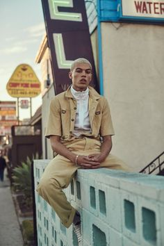 Dudley O'Shaughnessy sports a Kenzo jumpsuit with a Kenneth Cole top.