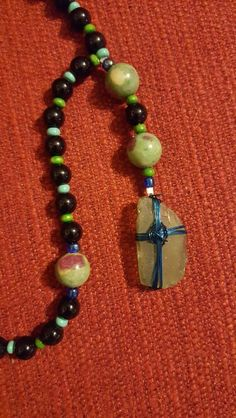 Sea glass and wire cross (detail)
