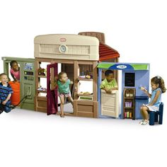 6-in-1 Towncenter Playhouse - This innovative backyard playhouse expands into an entire town. $459.99 US