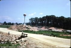 Interstate 64 construction at Staples Mill in August 1965. Water tower possibly Crump Company, later GE, then AT&T, then torn down. Location of water tower and any visible buildings is now Comcast. [permission granted by Jeff Hawkins]