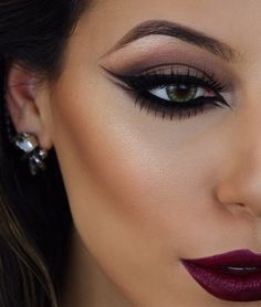 Graphic eyeliner + bold lip.
