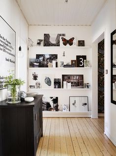 A resting / nesting gallery wall with shelves. Art shelves are perfect for the art collecting who doesn't wants the flexibility of changing art pieces every few months without the hassle of having to hang works up!