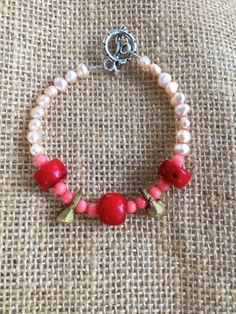 fresh water pearls, corals, shells and cast brass spirit bells