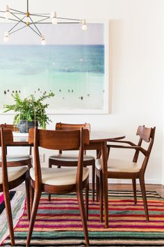 Henderson enlarged a surfing photo by Max Wanger to make a statement in the dining room.