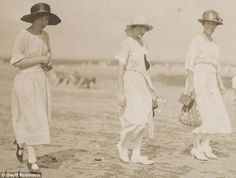 "Photograph by Geoff Robinson: 1923, ""Bathing beauties: Three women head towards the water dressed in their Sunday best in Cliftonville in 1923."""