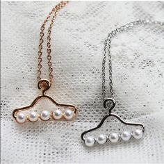 Silver plated clothes hanger charm necklace New, never worn. Cute silver plated clothes hanger charm necklace decorated with white faux pearls. Also available in gold, see separate listing. Thank you for visiting my closet, please let me know if you have any questions, I offer great discounts on bundles :) Boutique Jewelry Necklaces