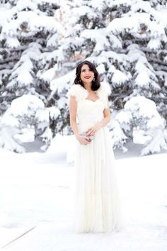 Pink Peonies styled the Niceties Dress, Effie Topper, and Crystalline Clutch from BHLDN for a snowy white holiday look.