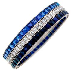 Smashing Art Deco bracelet created by Cartier in France in the 1930's. Tasteful combination of sky blue table cut sapphire, deep intense blue French cut sapphires and white round cut diamonds is a highlight of this amazing jewel.