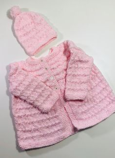 3-6 months US kids' numeric  This dress is super soft and comfortable . Wear it casually or dress it up for any occasion .It is 100% hand knitted like our grandma used to make .   Hand knitted in 100% low Acrylic