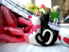 black whyte cats in love.dotted pink bow.made by polymer clay