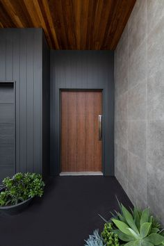 timber flooring produced an entrance thats tactile, bold and dare we say it, groovy. The Weathergroove range is a vertically grooved timber cladding designed to accompany any home and any material palette. We just adoor it! Cladding Design, Exterior Wall Cladding, House Cladding, Timber Cladding, Facade House, Cladding Ideas, Black Cladding, Timber Flooring, House Entrance