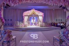 Vintage Altar with Purple Flowers and Curtains on Preston Bailey's Event Ideas