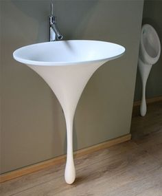 Funky funnel shaped sink (and urinal) by Phillip Watts Design.