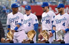 Kansas City Royals catcher Salvador Perez (13), manager Ned Yost, first baseman Eric Hosmer (35) and left fielder Alex Gordon (4) received their Gold Gloves before Friday's baseball game against the Oakland Athletics on April 17, 2015 at Kauffman Stadium in Kansas City, Mo.