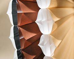 Hunter Douglas Duette Architella fabric honeycomb window shades provides insulation.