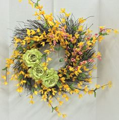 Spring 2015 Season Wispy Grapevine Wreath: With Georgia Roses, Pink berries and Forsythia. Original design and arrangement by http://nfmdesign.synthasite.com/