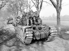 Churchill tanks of 6th Guards Tank Brigade carrying paratroopers of the 17th US Airborne Division, 1945. #WW2