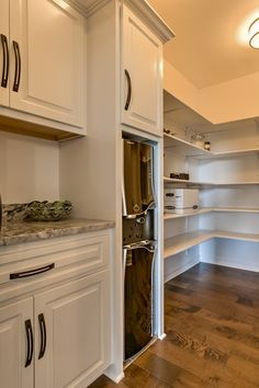 Walk-in pantry in the Brandenburg 1.5-story plan by Landmark Performance Homes.  www.buildalandmark.com.