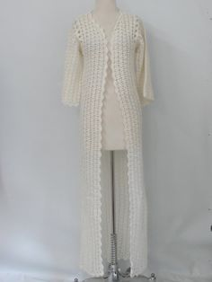70s -Hand Crochet- Womens white, acrylic fiber, floor length cover up, with a clutch front and long sleeves, finished with a scalloped edge stitching. This garment measures 57in from shoulder to hem.