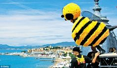Beehave: Jerry Seinfeld jumps off the Carlton Hotel dressed as a bee to promote 'Bee Movie' during the 60th Film Festival in 2007