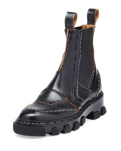 """Balenciaga calf leather Chelsea boot with stapled-trim. 1"""" stacked heel. Round toe. Gored side insets. Contrast leather trim. Pull-tabs ease dress. Rubber outsole. Made in Italy."""