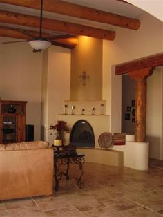 Column partial wall with matching wood header beam.tons of character Southwestern Home, Southwestern Decorating, Southwest Decor, Southwest Style, Southwestern Fireplaces, Hacienda Homes, Hacienda Style, New Mexico Homes, New Homes
