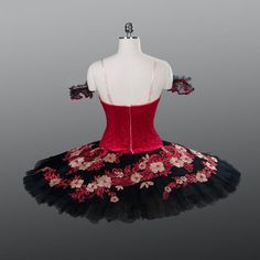 New Collection YAGP 2018! An amazing tutu for the role of Kitri in Act III. The deep red bodice is made with semi elastic fabric, featuring a nice printed pattern. The bodice fastens in the back with a double row of hooks and eyes. Multiple types of decorations have been used for this bodice: red sequins, gold, and silver and black appliques, as well as red crystals. The arm bands are made of black tulle, with red accents. The 10 layers, professional tutu skirt is the real highliht of this…