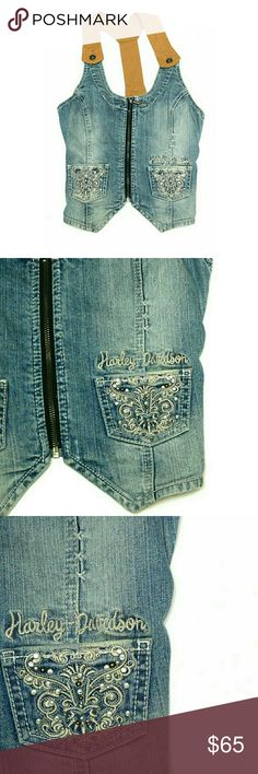 """HARLEY DAVIDSON DENIM FRONT ZIP RACER BACK TOP HARLEY DAVIDSON DENIM FRONT ZIP RACER BACK TOP  Pre-Loved/EUC SZ S  CUTE! CUTE! CUTE! Denim Front Zip , 2 Front Embellished  Pockets, Tanisha Racer Back Detachable Straps Connected in Front & Back  Approx Meas;    Pit to Pit   16 1/2""""    Shoulder Top to Point of Hem   21""""  Colors May Not be Exact due to Lighting or Ur Screen  Meas R Approx & Can be Interpreted Differently on How U Measure Harley-Davidson Tops"""
