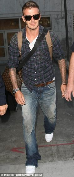Check shirt. White t-shirt. Jeans. Belt. Rucksack. Watch. Sunglasses. Beckham.