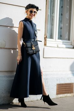 Everyone In Paris Is Wearing A Leather Beret #refinery29 http://www.refinery29.com/2017/09/174062/paris-fashion-week-street-style-spring-2018#slide-18