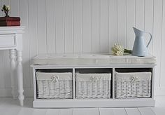 A white storage bench with 3 storage baskets. A simple but beautiful design with buttoned cushion included    Ideal as a storage bench in a hallway, living room, as a window seat or at the end of your bed.    Store clothes, shoes, toys or games in the deep baskets of this storage bench.    Storage Bench Dimensions:  Height inc cushion : 44cm (cushion 5 cm deep)  Width: 110cm  Depth: 36cm    Fully assembled    Price: Was £225 Now £200