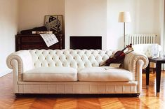I will have a white tufted couch.