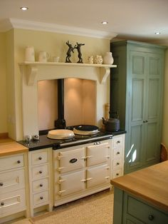 Rustic style kitchen showing an over mantel supported by carved corbels. You can buy similar corbels. Aga Kitchen, Unfitted Kitchen, Rustic Kitchen, Vintage Kitchen, Kitchen Decor, Kitchen Ideas, Cottage Kitchens, Home Kitchens, Cottage Shabby Chic