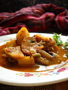 mushroom vindaloo recipe - spicy and hot recipe of mushroom from portuguese goan cuisine. step by step recipe.