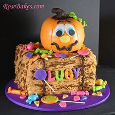Pumpkin on Bale of Hay with Candy Cake for a Halloween Pumpkin Patch Party