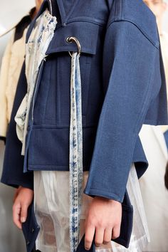 Ximonlee explores what it means to be a tough guy with acid-wash denim and tailored tarpaulin.