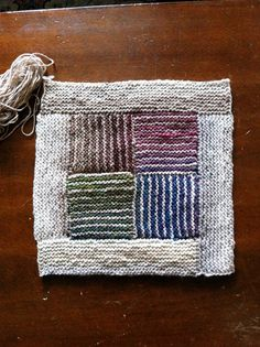 Muted, striped log cabin square. You could stripe any of the logs, depending on your scrap stash.