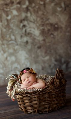Create precious newborn portraits with the new arrival snuggled into a Cozy Confetti throw blanket, wearing a custom-made Confetti Headband, and nesting in the woven vines of a Lil' Gatherings Basket. Shown here with a brown Boho Backdrop (a wrinkle-resistant polyester blend), and a dark Rugged Barnwood floor that can double as a backdrop.